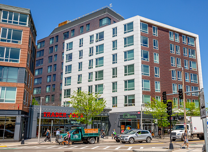 Exterior image of Continuum, Our Fathers and Trader Joe's in Allston
